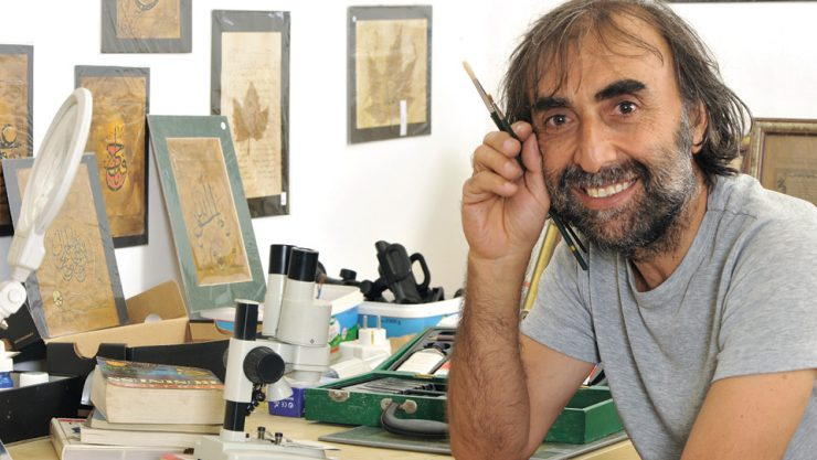 HE PRODUCES THE WORLD'S SMALLEST ART PIECES