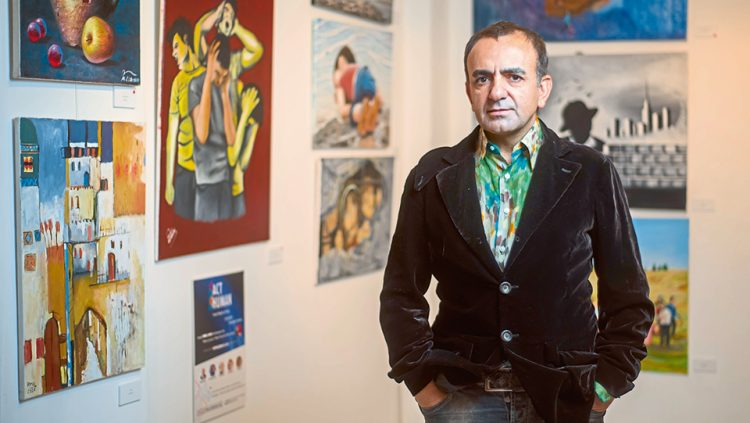 HE SIGNS UNDER AN EXHIBITION DEDICATED TO PEACE: İSMAİL ACAR